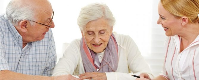 geriatric care manager helping elderly couple