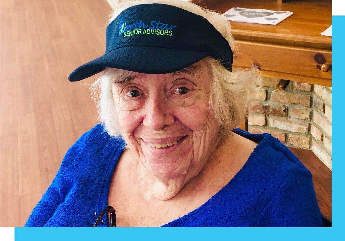 elder female client with north star visor on