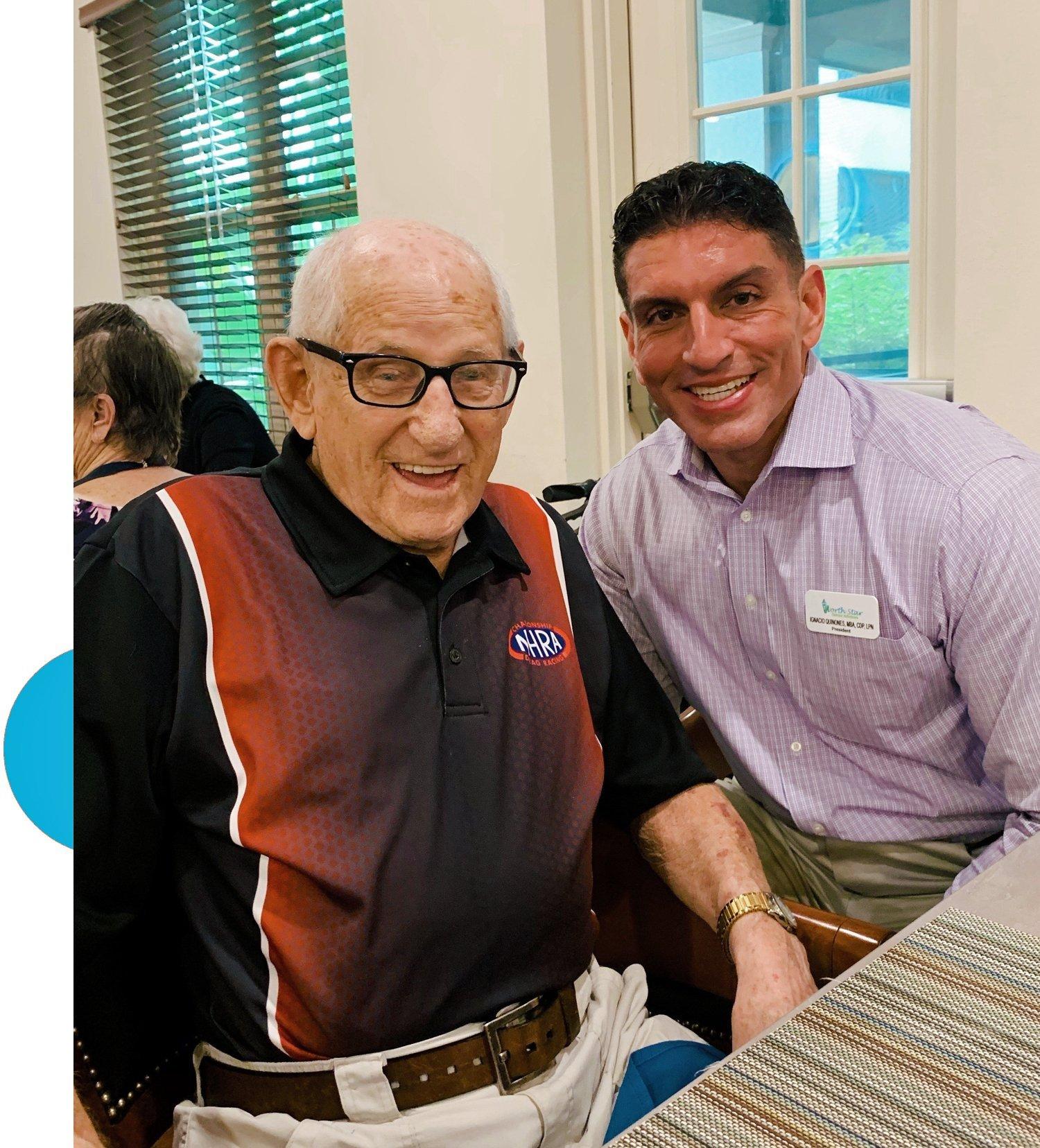 Ignacio with geriatric care client and blue semi circle