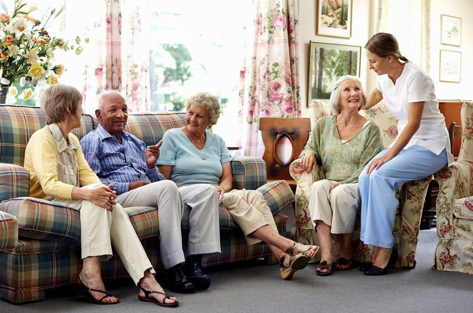 senior living residents sitting and having conversation