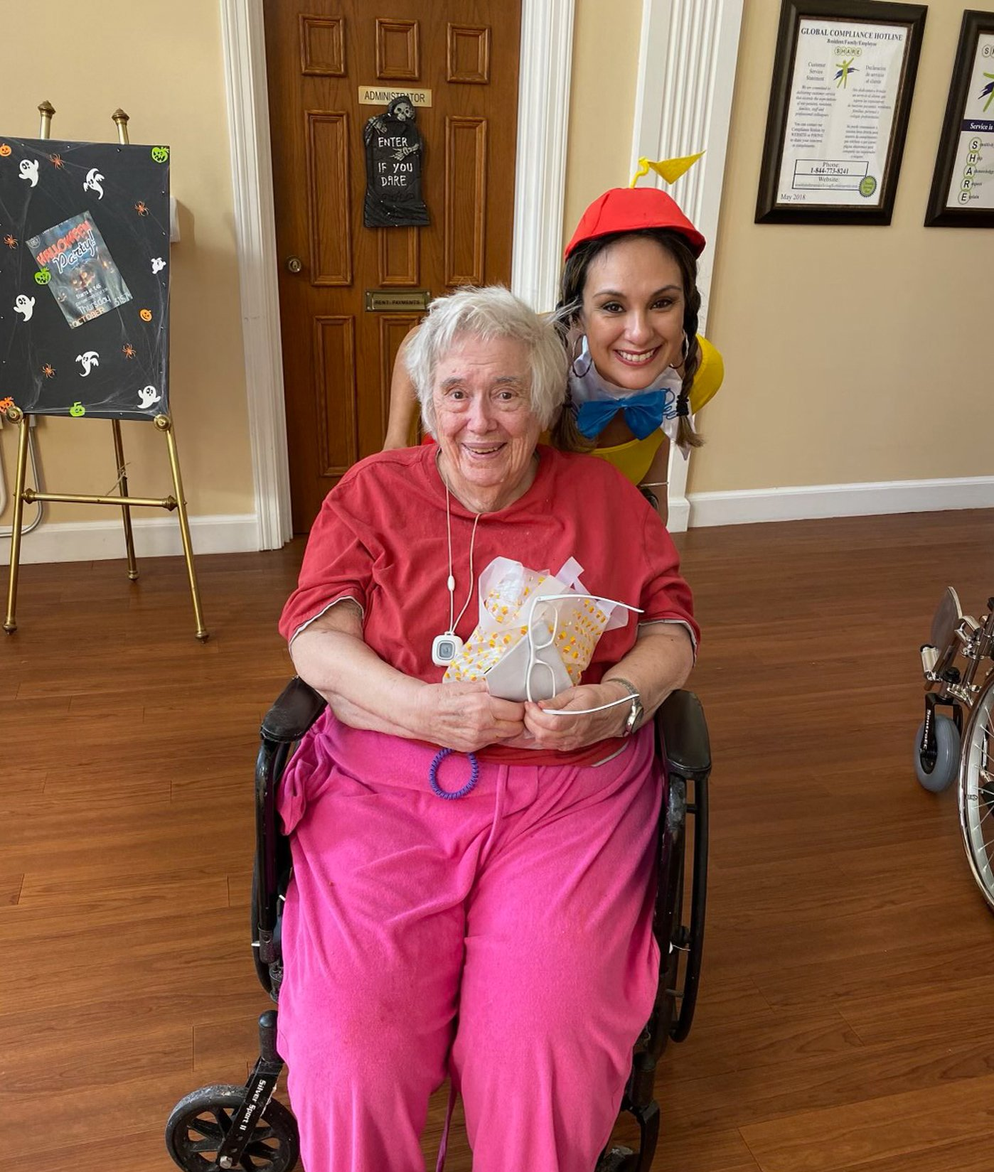 Veronica pushing elderly woman in a wheelchair